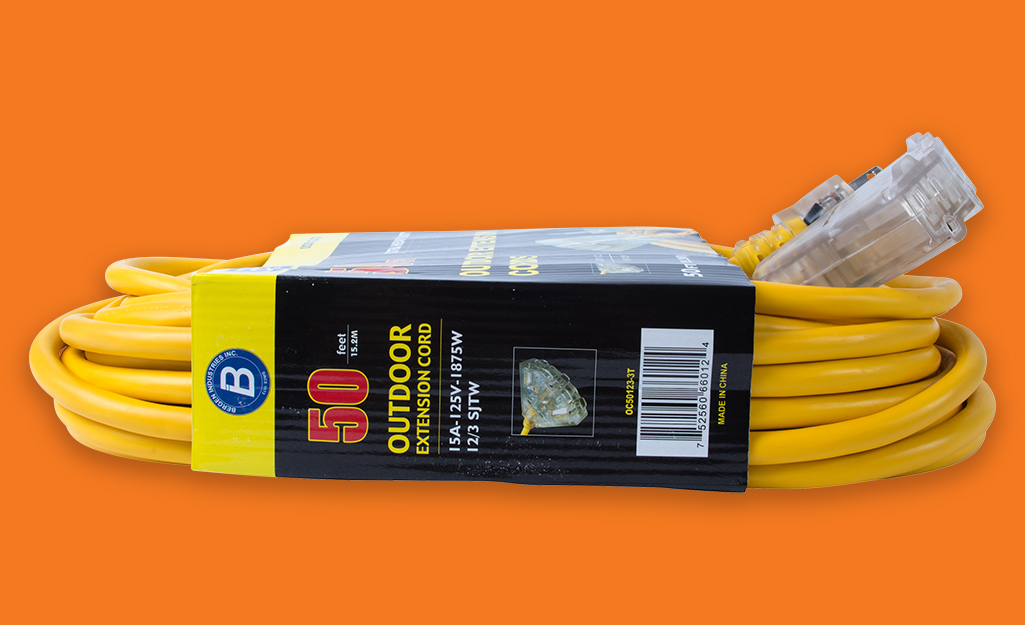 A new extension cord wrapped in packaging.