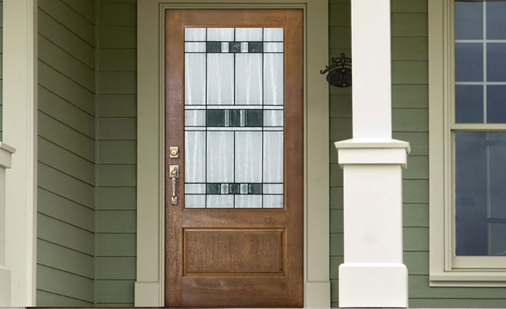 An exterior door with decorative glass.