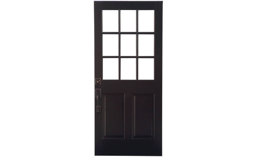 A dark exterior slab door with a nine-pane grid.