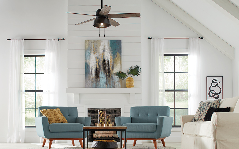 a wood-like ceiling fan cooling an open floor living room.