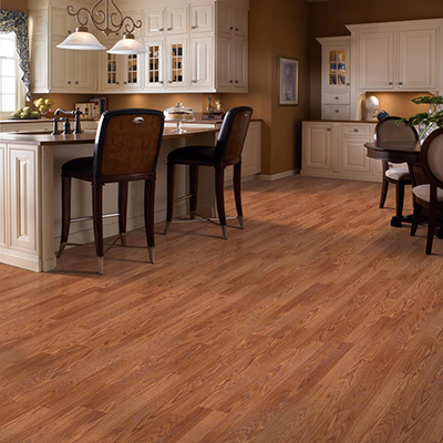 A kitchen and dining room with luxury vinyl plank flooring that resembles hardwood.