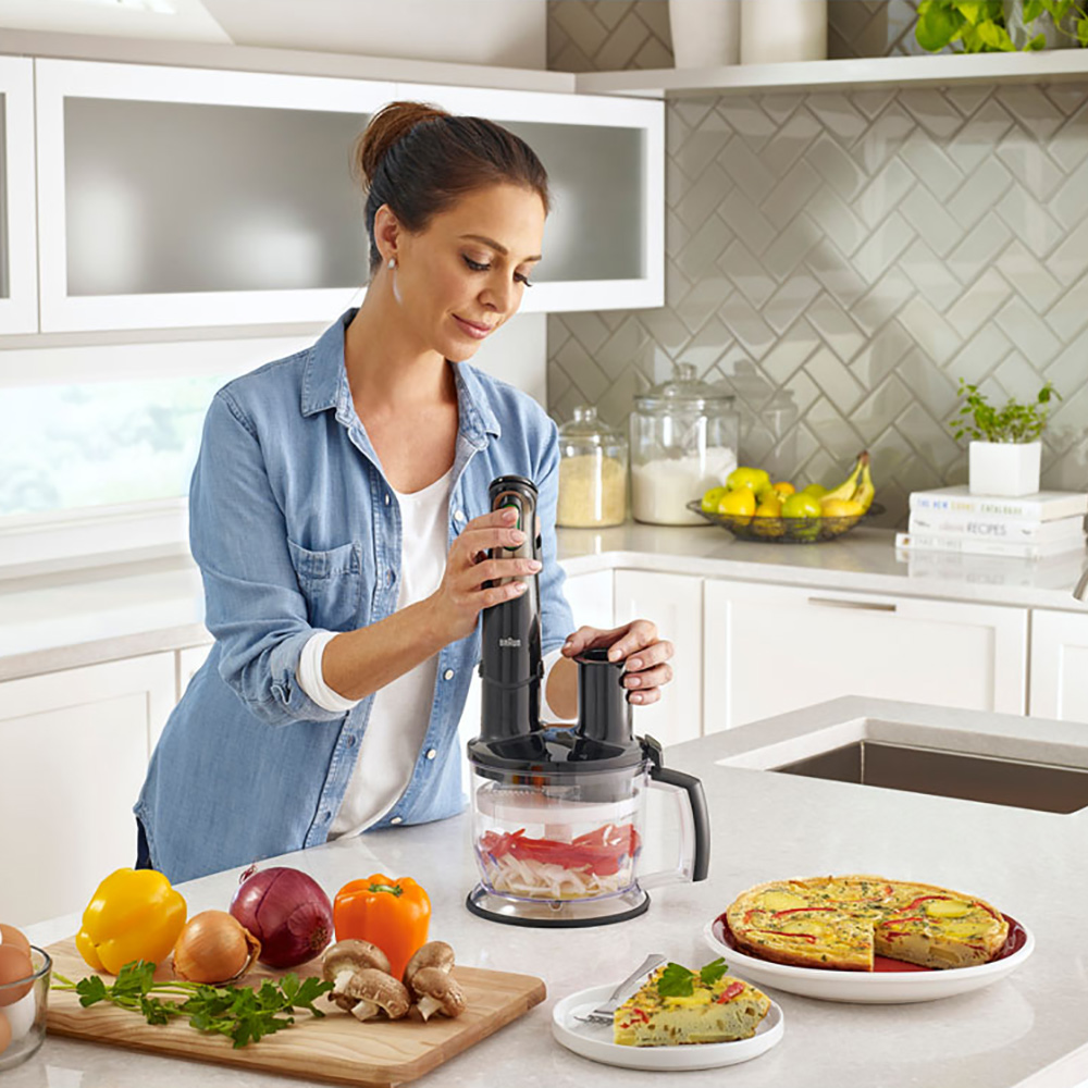 woman using a food processor in kitchen