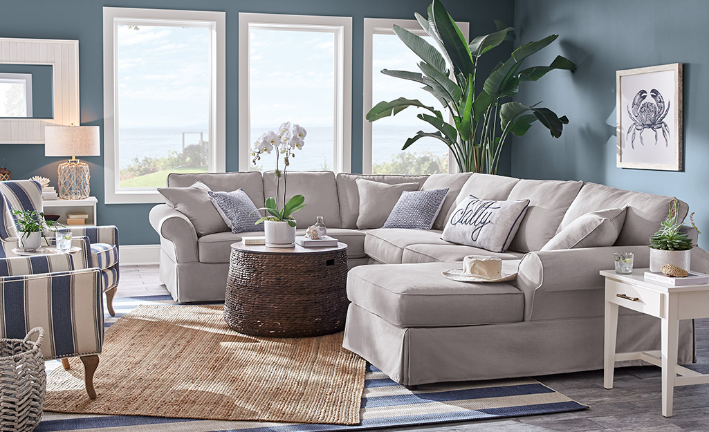 A sectional sofa sits in a Coastal inspired living room.