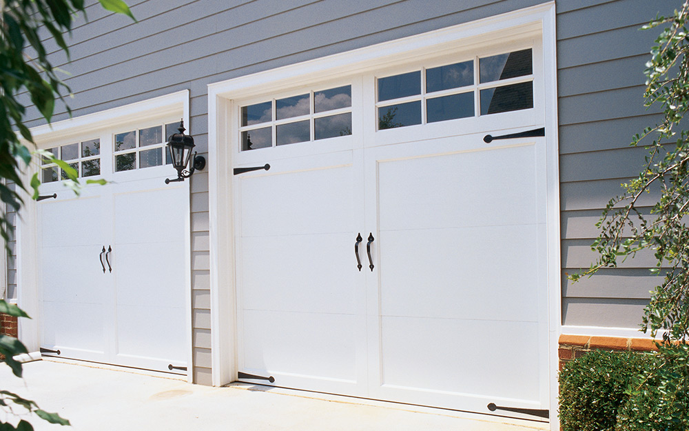 a carriage style garage door with windows