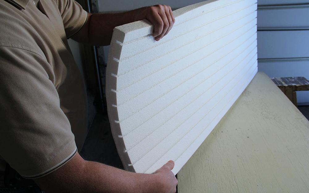 A man displaying garage door installation.
