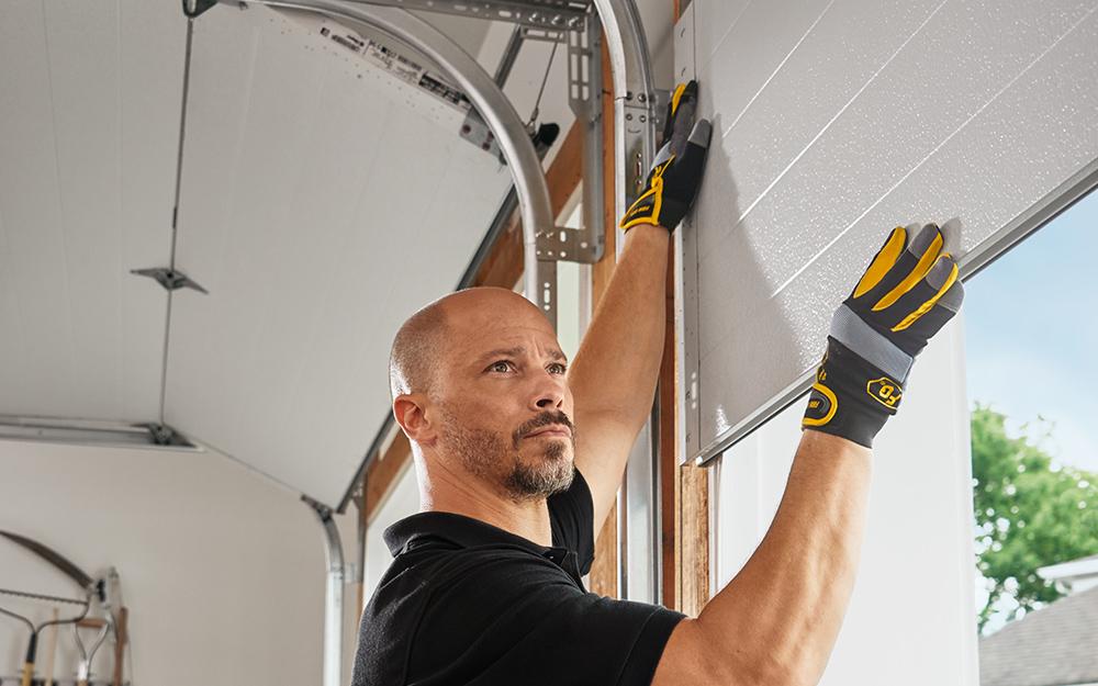 a man installing a garage door