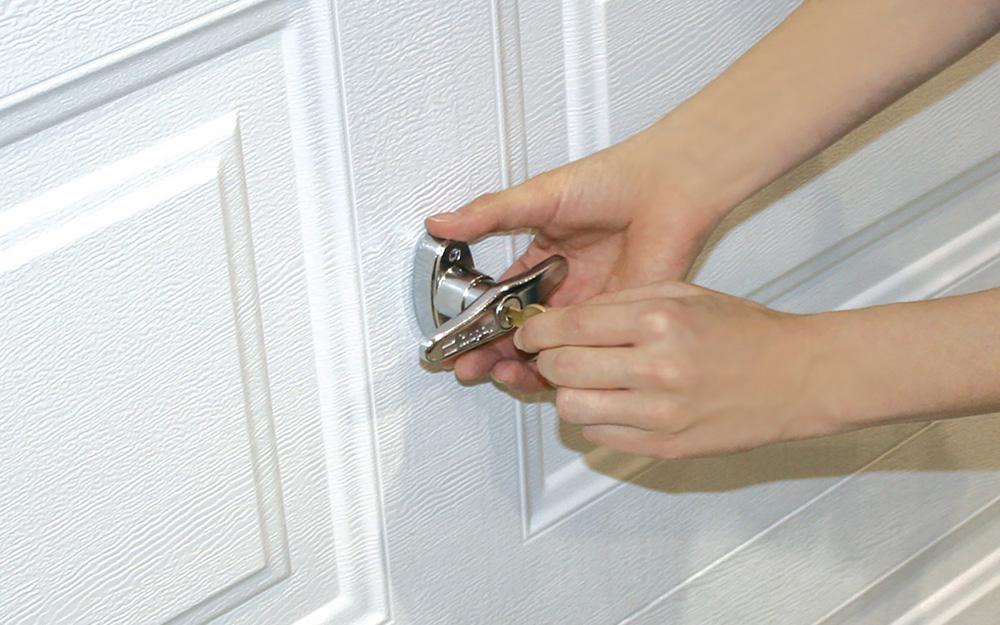 Someone locking a garage door.