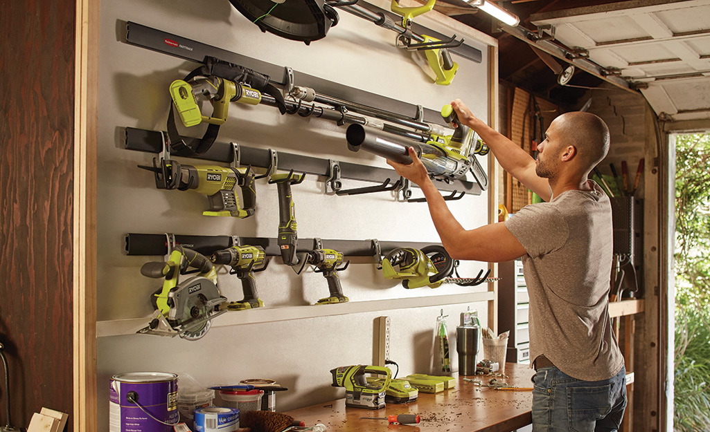 Outdoor power tools stored in a garage
