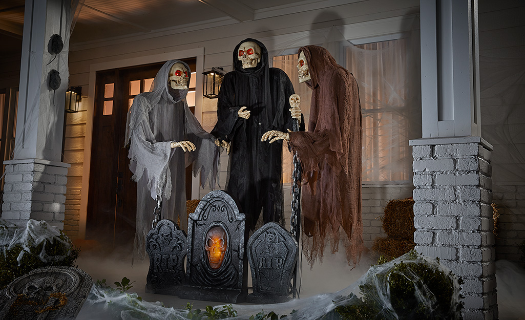 Halloween skeletons on a front porch