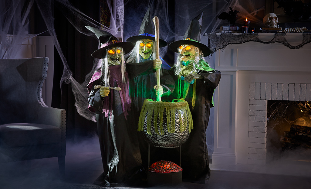Animated witch figures with a cauldron