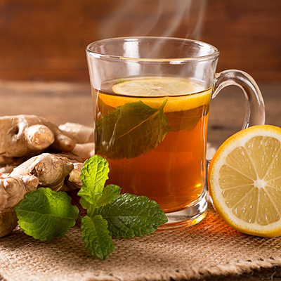 A cup of tea with mint, ginger and lemon