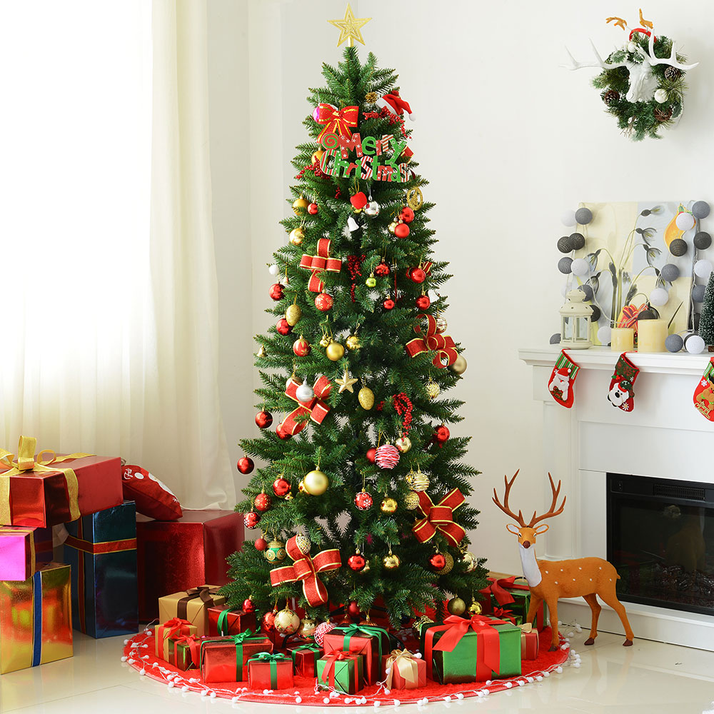 A Christmas tree with presents around it.