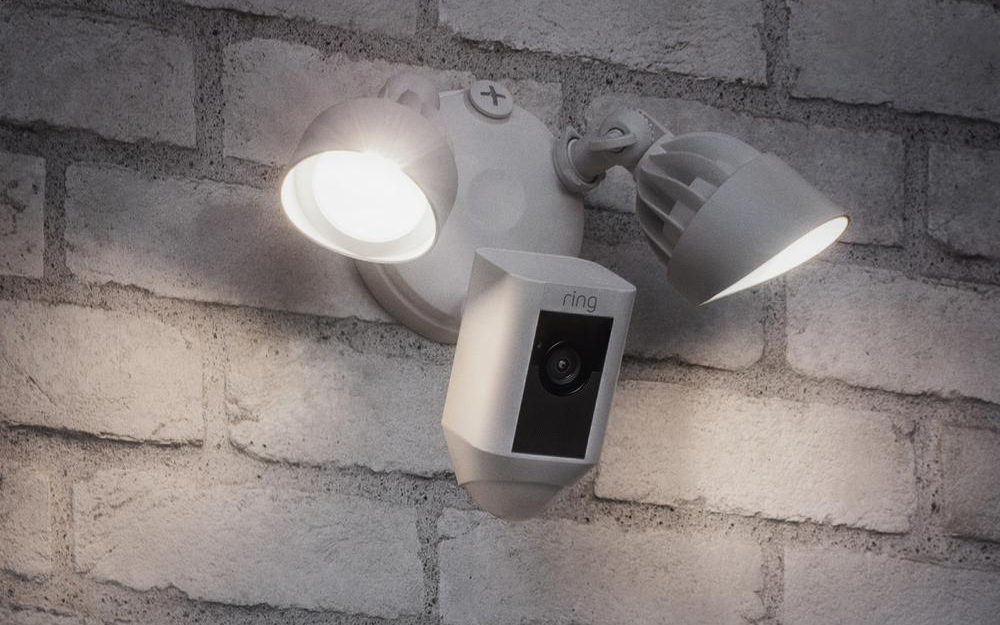 Lights with a motion sensor on an outside wall.