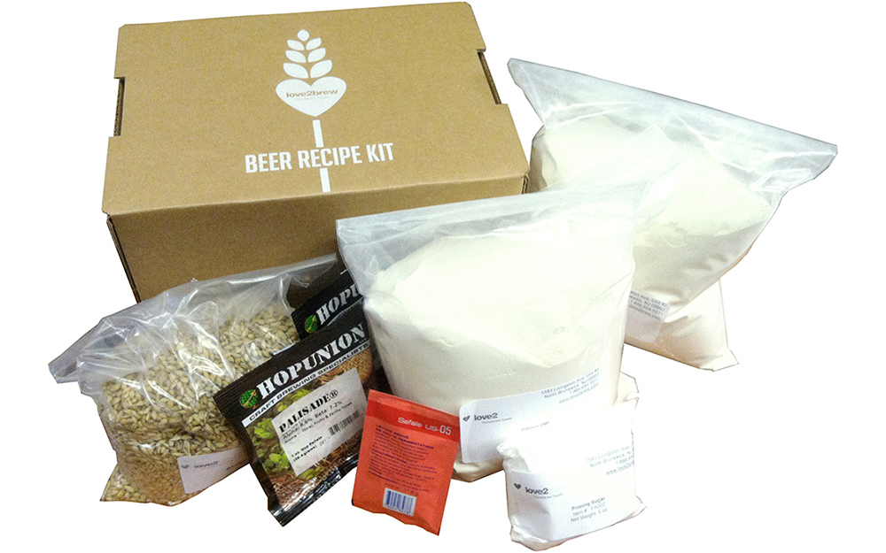 A homebrew recipe kit with bags of ingredients.