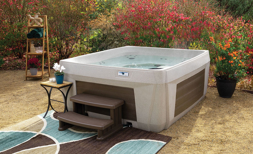 A backyard hot tub equipped with stairs.
