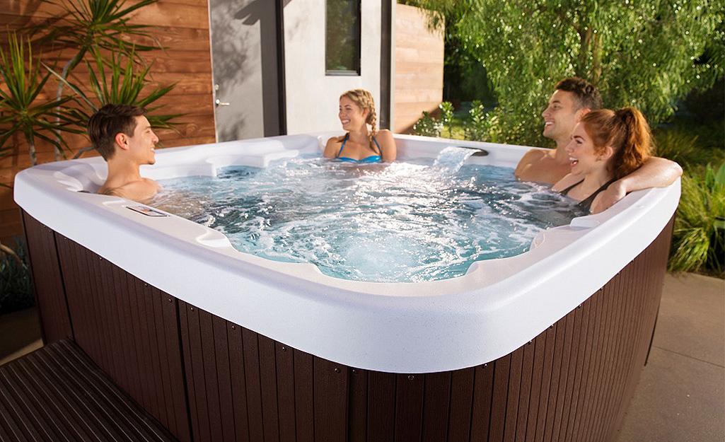 People enjoying an outdoor hot tub.