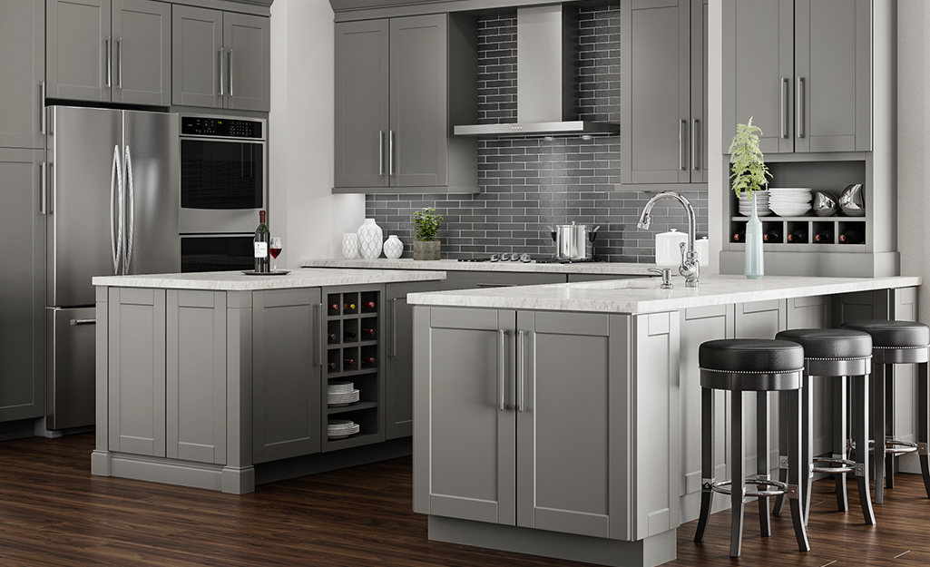 A kitchen with gray Shaker cabinets.