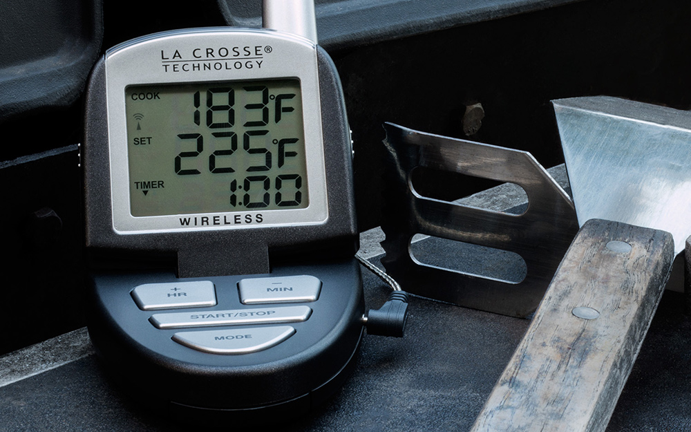 A digital meat thermometer has a programmable display screen.