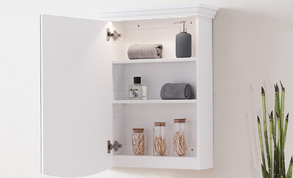 A medicine cabinet with a light.