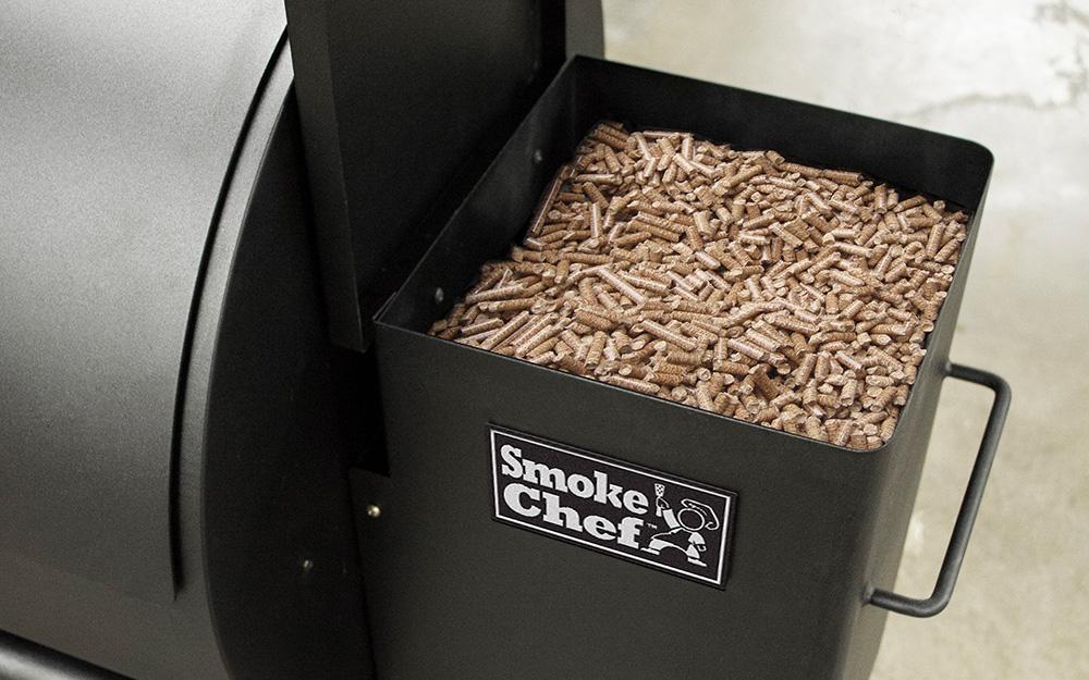 Grill pellets sit inside a smoker.