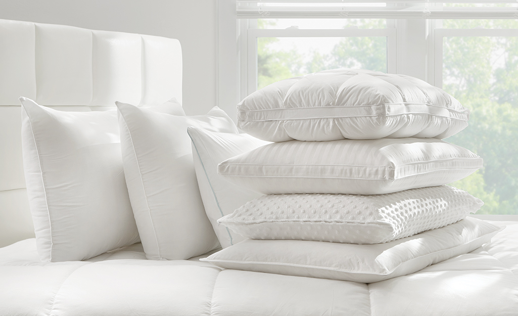 A memory foam pillow sits on a bed.