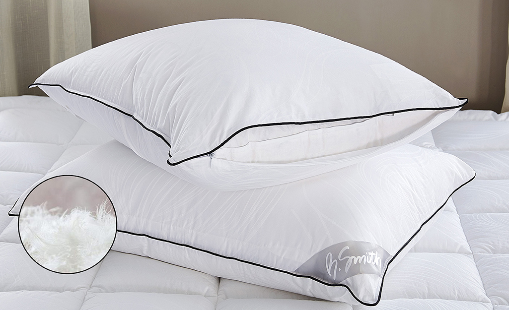 Down pillow on a bed.