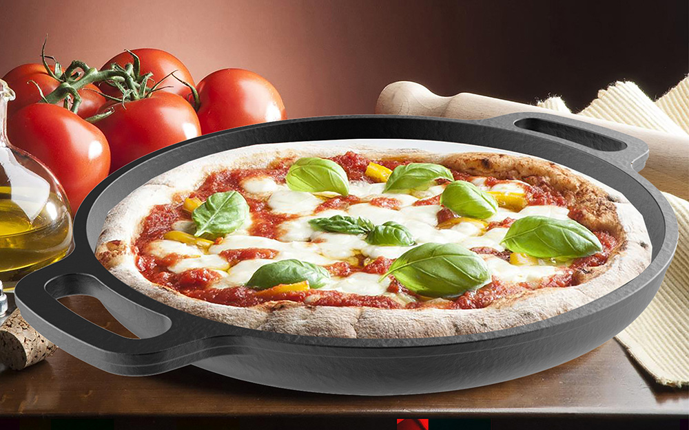 A pizza sits in a pizza stone with built-in handles.