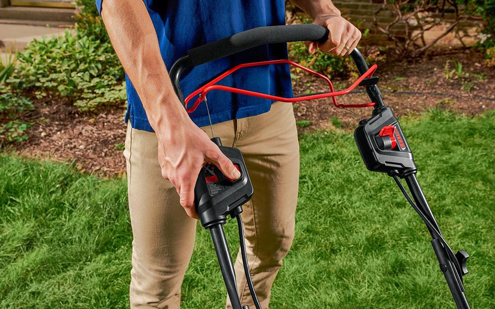 Man adjusts handles on push power.