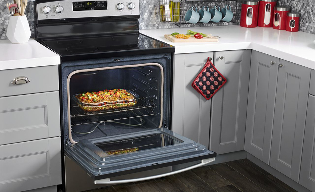 An electric range stove top oven.
