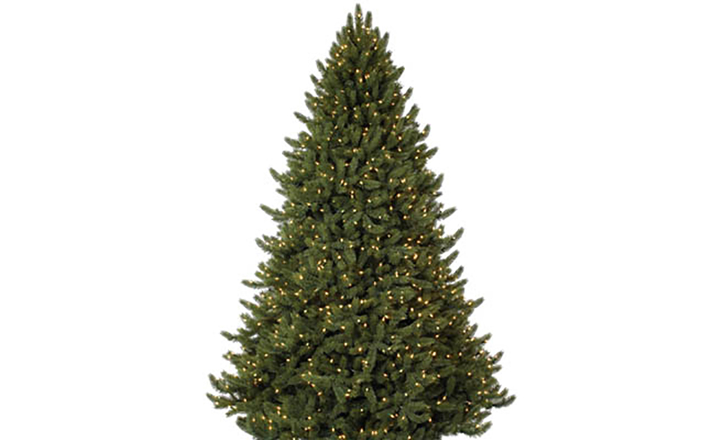 A white spruce Christmas tree with lights against a white background.
