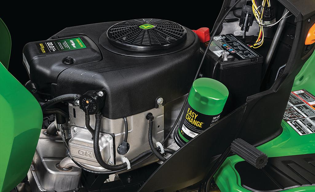 A closeup image of a riding mower engine.