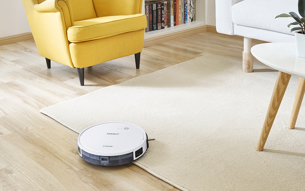 A robot vacuum on an area rug