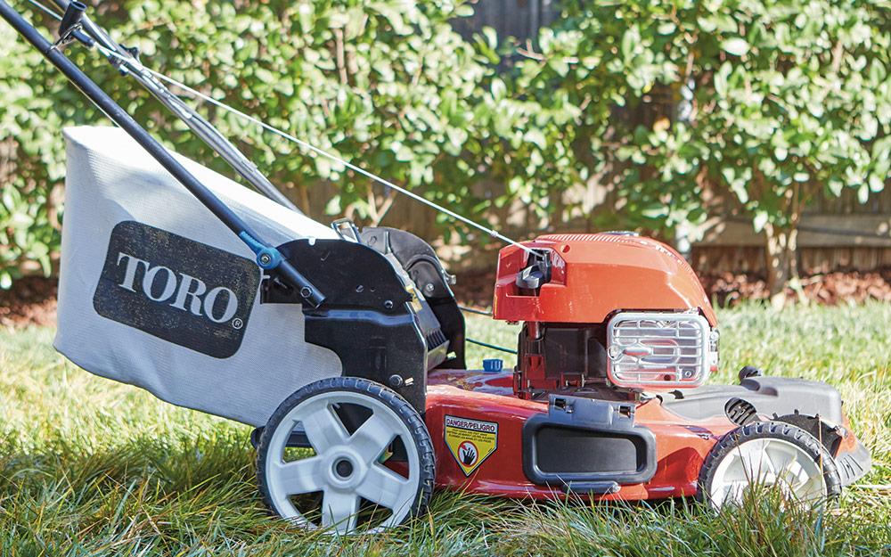 self-propelled lawn mower preparing to mow lawn