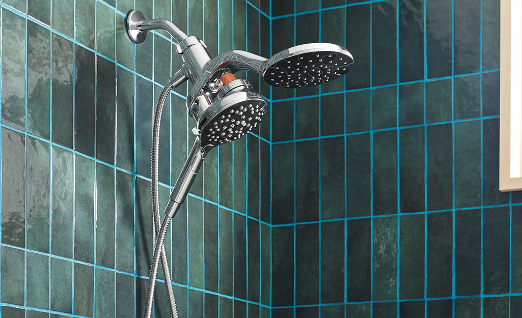 A shower head mounted to the shower wall.