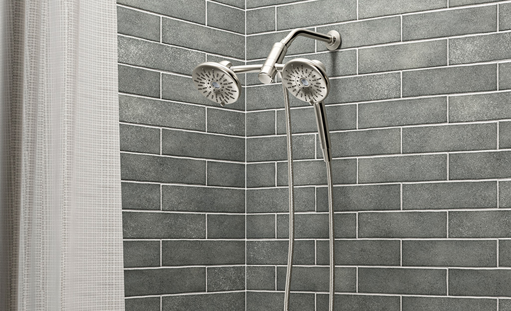 A dual shower head in chrome finish.