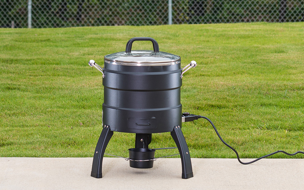 An electric smoker includes a power cord.