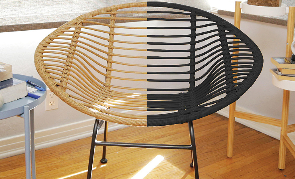 One half of round chair has been spray painted black, while the other side remains the original brown color.