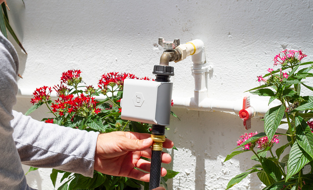 Sprinkler attachment with water timer.
