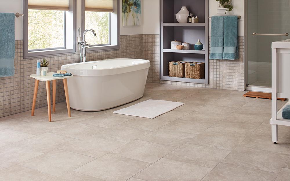Các ô vuông lát gạch lớn trên sàn phòng tắm.