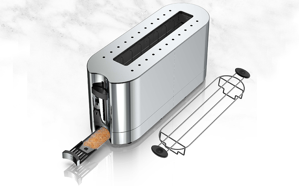 stainless steel toaster with bread crumb tray and warming accessory