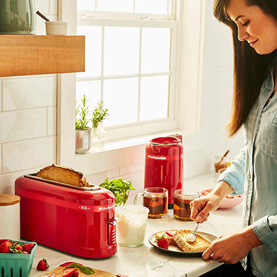 woman using a 2 slice toaster