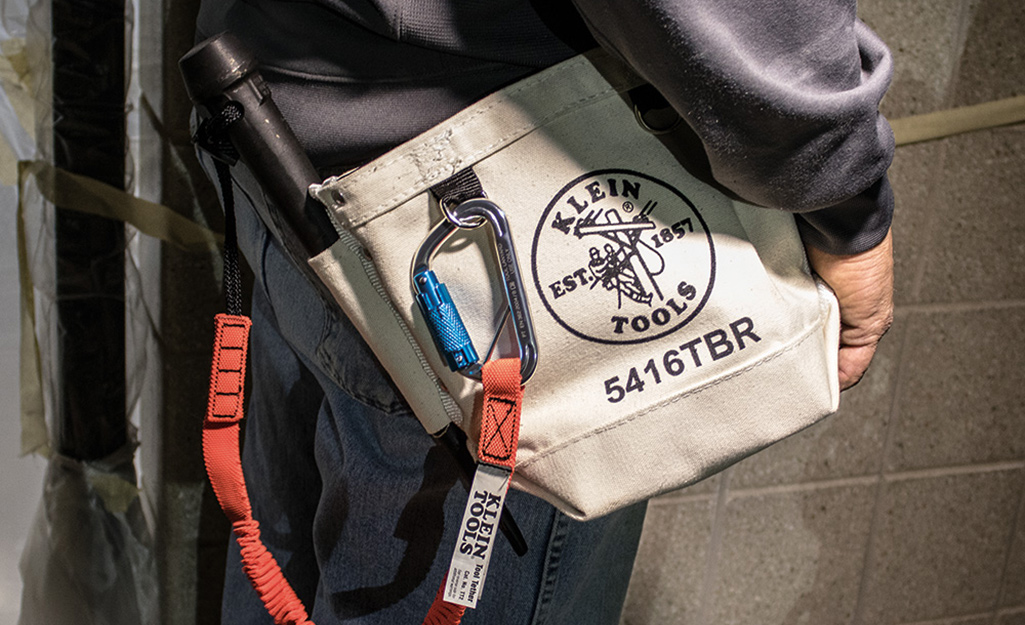 This is a tool pouch with a strap.