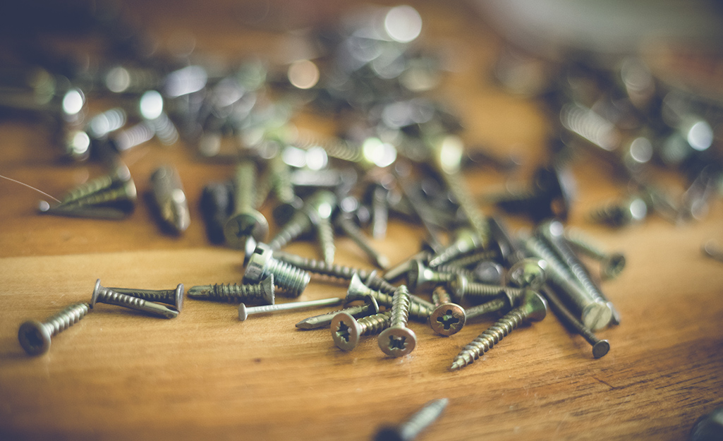 Various nails and screws on a counter.
