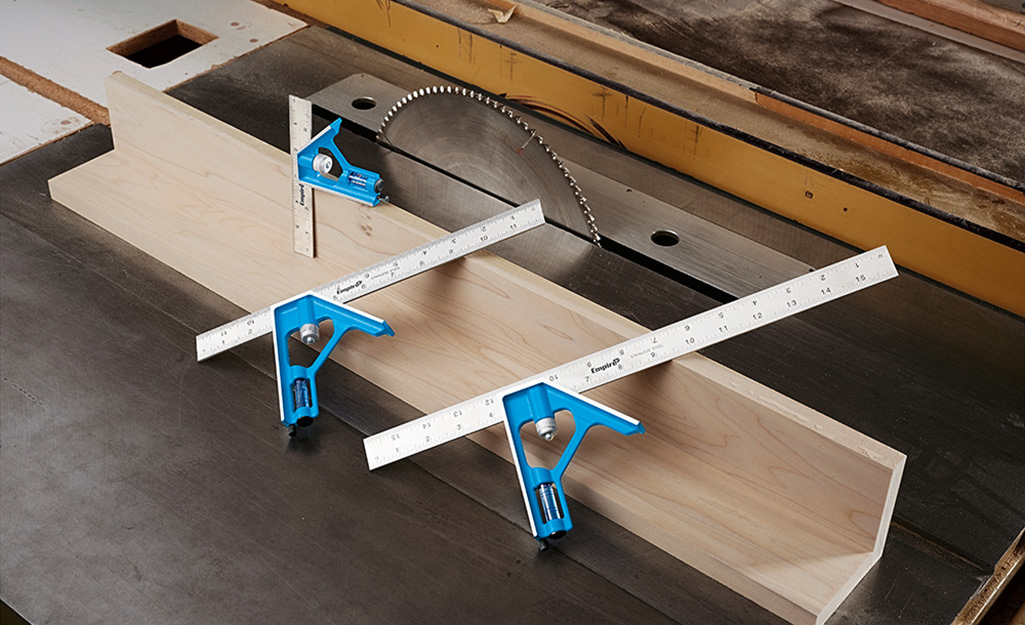 A set of combination squares are used on a woodworking project.