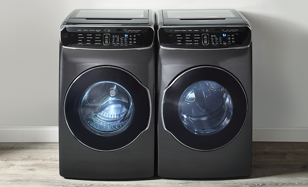 A black washer and dryer sitting side by side.