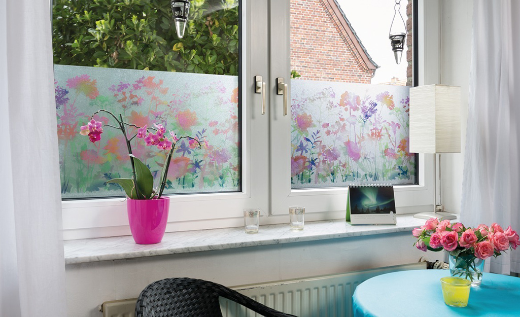 A window coated with decorative floral window film.