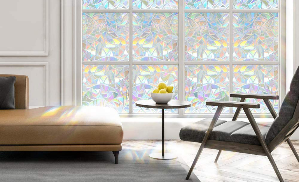 Decorative window film on a window with multiple panes.
