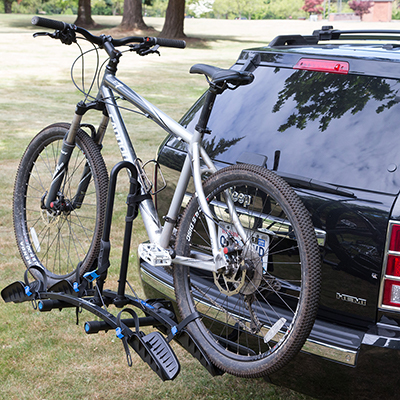 the back of an SUV with a bike and bike rack attached