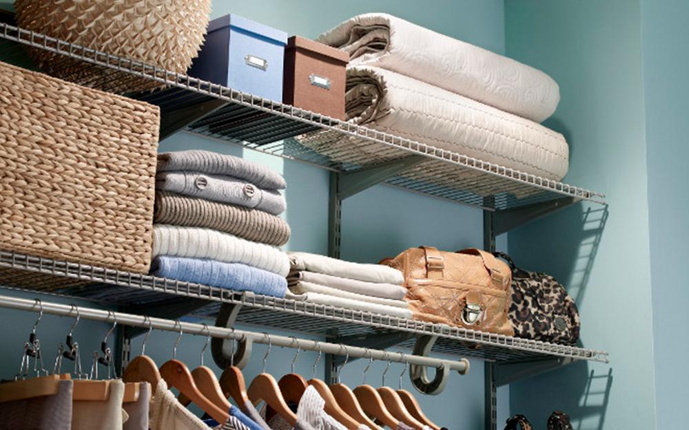 Folded blankets stored on a closet shelf.