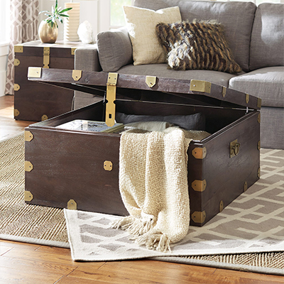 An open storage chest with a blanket inside.